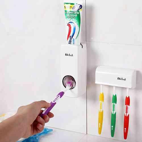Auto Toothpaste Dispenser/Squeezer & Toothbrush Holder Set.